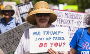 Protesters take part in an anti-Trump tax march in Atlanta in April.
