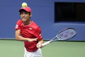 Yoshihito Nishioka returns a shot to Andy Murray.