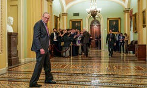 Chuck Schumer walks outside the Senate chamber during break in the trial.