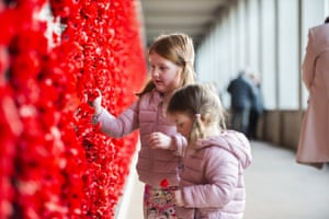 Two girls at the poppy wall