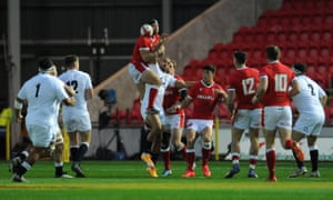 England's Jonathan Joseph knocks Leigh Halfpenny of Wales off his stride at Parc y Scarlets