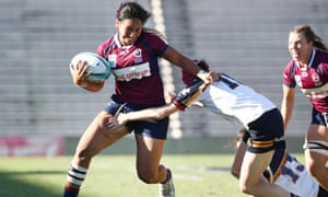 Queensland's Cecilia Smith breaks through a tackle during the Super W preliminary final.