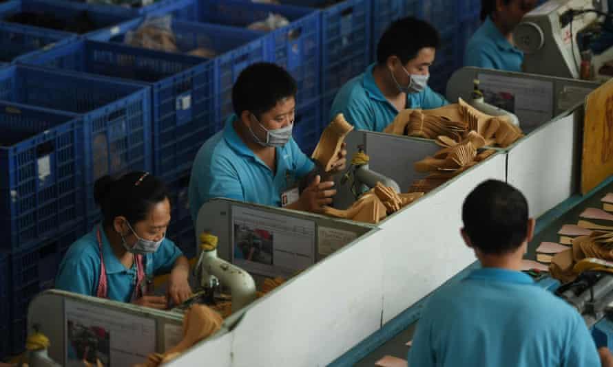Workers at Dongguan's Huajian shoe factory.