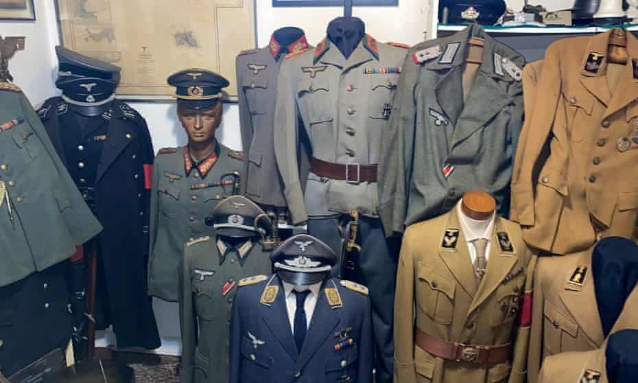 A handout photo released by police shows Nazi uniforms. Luis Armond, the lead detective on the case, said a museum would need to be found for the collection.