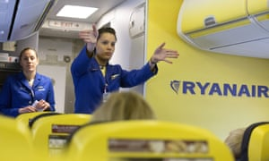 Ryanair cabin crew performing a safety demonstration.
