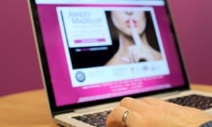 A man wearing a wedding ring looks at the Ashley Madison website.