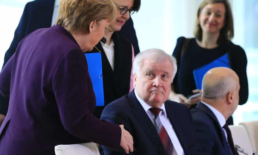 German Interior Minister Horst Seehofer refuses to shake hands with the German Chancellor Angela Merkel