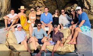 Jeff Bezos, bottom row, right, wearing his trend-setting swimming shorts on board David Geffen's yacht.
