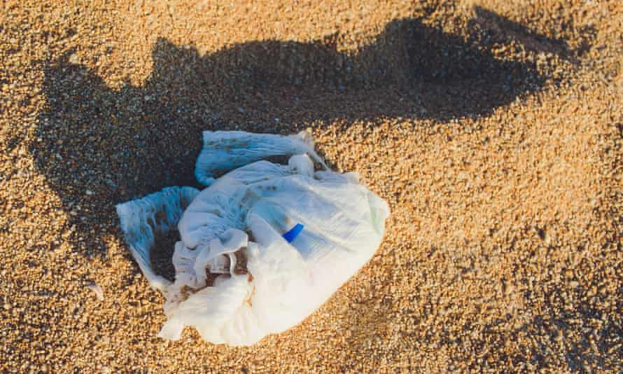 Disposable nappy on a beach