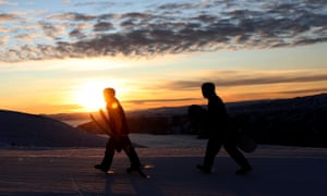 Skiers and snowboarders arrive on opening day of the snow season in Cardrona.