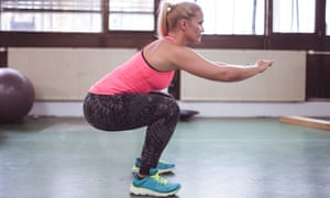Woman working out in the gym: squat