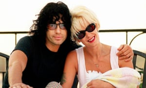 Truly, madly, deeply: Michael Hutchence and Paula Yates in 1997, shortly after the birth of their daughter, Tiger.