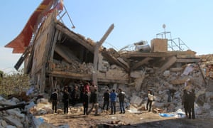 People gather around the rubble of a hospital supported by Médecins Sans Frontières near Ma'aret al-Numan, in Syria's northern province of Idlib, on February 15, 2016, after the building was hit by suspected Russian air strikes.