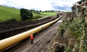 An engineer walks along a stretch of National Grid gas pipeline near Skipton in North Yorkshire.