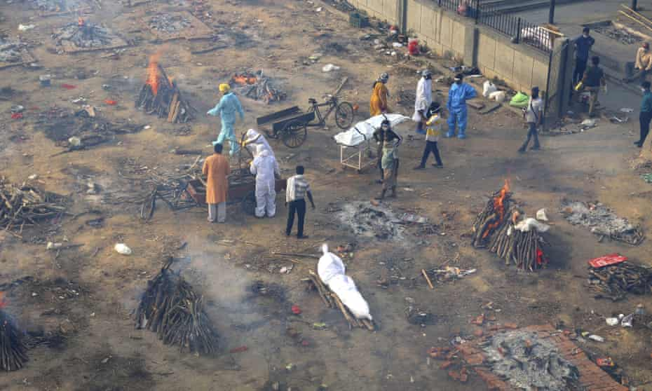 Multiple funeral pyres of patients who died from Covid, at a ground that has been converted into a crematorium for mass cremation of coronavirus victims in Delhi.