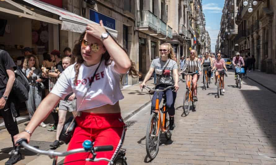 Visitors ride bikes in Barcelona
