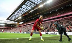 Liverpool's Dejan Lovren receives the ball from a ballboy