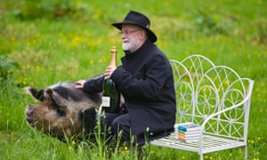 Terry Pratchett pictured in 2012 after winning the Wodehouse prize for his novel Snuff – with his Bollinger and porcine prize.