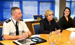 Theresa May talks with officers from Police Scotland in Glasgow.