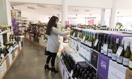 Woman buying alcohol