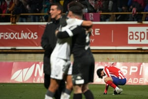 João Félix slumps to the ground after their 2-1 defeat in extra-time.