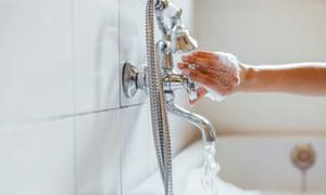 Closeup of anonymous woman preparing a relaxing bath.