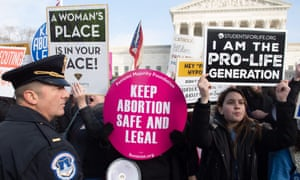Pro-choice activists hold signs alongside anti-abortion activists outside the supreme court in January.