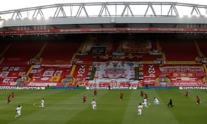 Liverpool and Crystal Palace players kneel before starting at Anfield.