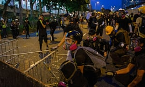 Protesters gather behind a makeshift barrier in Tai Po.