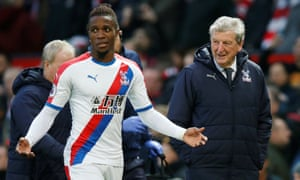 Crystal Palace's Wilfried Zaha and manager Roy Hodgson.