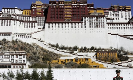 A paramilitary policeman stands guard in front of the Potala Palace in Lhasa, Tibet.
