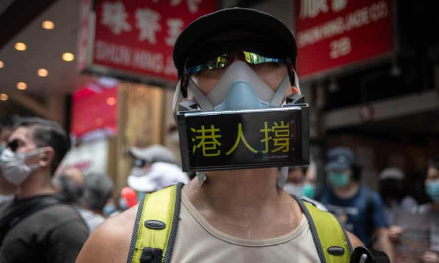 A protester wears a mask with anti-China messages during a demonstration in Hong Kong.