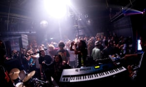 A view from the stage at club OT301, Amsterdam, which takes in a large crowd of people dancing under vibrant spotlights.
