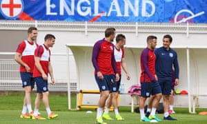 England's assistant coach, Gary Neville, talks to the players during a training session in preparation for their Euro 2016 opener against Russia