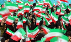 Students wave Iranian national flags