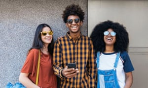Portrait of group of happy friends looking at camera in the street. Friendship concept
