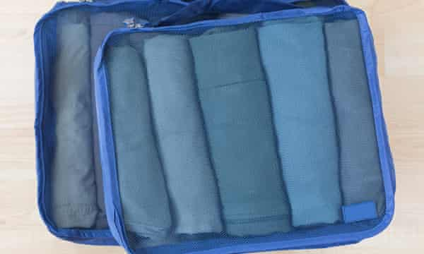 Packing cubes keep suitcases organised.