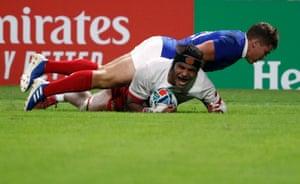 Tonga's Zane Kapeli scores their third try.