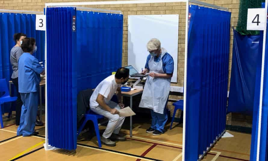 Dr Nolan Arulraj (in white) attending a vaccination centre in Cardiff.