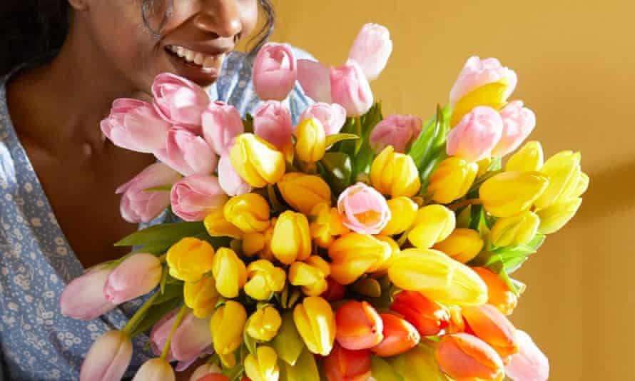 woman admiring B&W bouquet of tulips