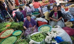 Women selling vegetables at market in Guatemala. Fewer fruit and vegetables will be available as a result of climatic changes, the research found.