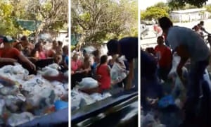 A criminal group hands out food supplies in the Mexican city of Apatzingán in Michoacán, Mexico.
