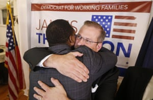 Thompson gets a hug from supporter Djuan Wash at the Murdock Theatre in Wichita.