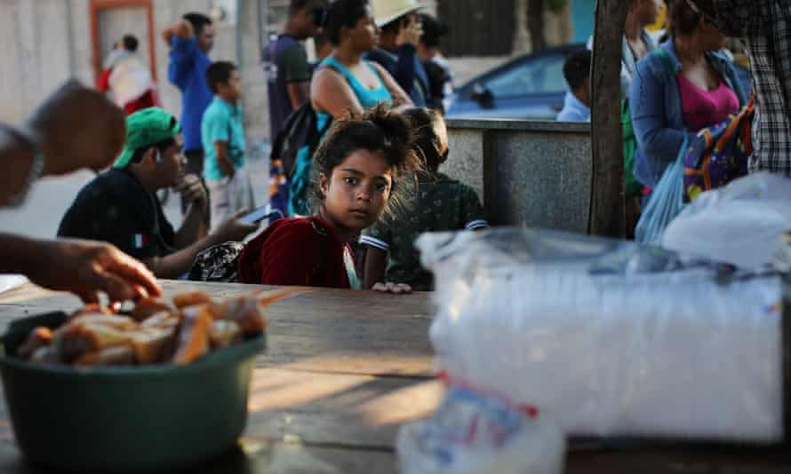 In Niltepec, members of the migrant caravan wait for water and food from the residents there.