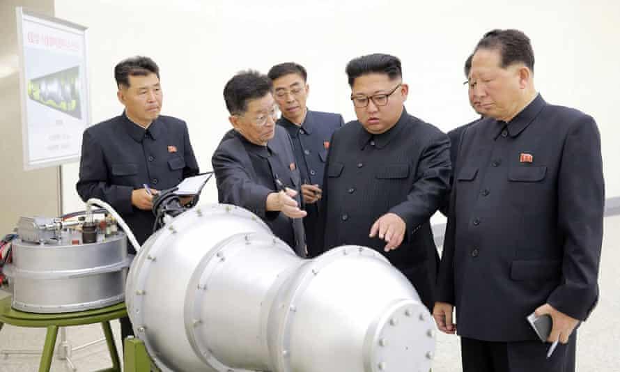 Kim Jong-un inspecting a device