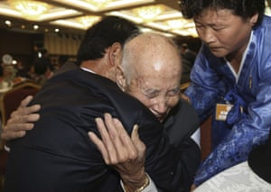 """North Korean Chae Hun Sik hugs his son. One man chosen to take part in the reunions told <a href=""""http://www.voanews.com/content/inter-korean-family-reunion-preparations-underway/3009842.html"""">Voice of America</a>: 'It makes my heart flutter. It's been a long time'"""