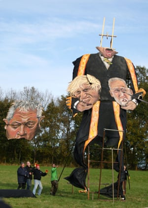 The finishing touches are made to an 11-metre effigy of Britain's Speaker of the House of Commons, John Bercow, holding the heads of the prime minister, Boris Johnson, and the Labour party leader, Jeremy Corbyn, in Edenbridge, UK