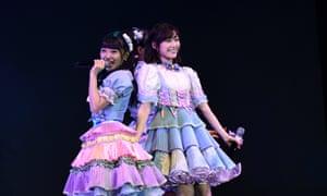 AKB48's Mion Mukaichi (L) and Mayu Watanabe.
