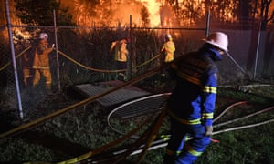 Firefighters fighting a bushfire in south-east Sydney.