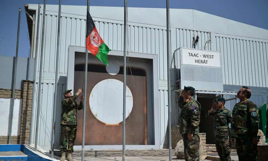 Afghan National Army (ANA) soldiers raise their national flag at the Italian Camp Arena military base, after Italian forces left.